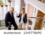 senior businessman and... | Shutterstock . vector #1245778690