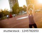 slender fit blonde woman doing... | Shutterstock . vector #1245782053