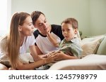 young family being playful at... | Shutterstock . vector #1245798979