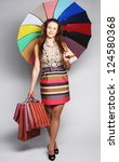 lovely woman with shopping bags ... | Shutterstock . vector #124580368