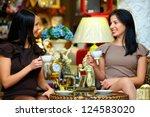 Two Elegant Ladies Have A Tea...