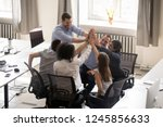 multiracial employees team with ... | Shutterstock . vector #1245856633