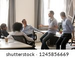 diverse colleagues sitting in... | Shutterstock . vector #1245856669