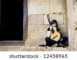 lone street artist near old... | Shutterstock . vector #12458965