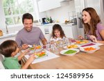 family laughing around a good... | Shutterstock . vector #124589956