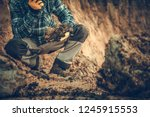 Caucasian Geologist Checking the Soil in the Construction Site. - stock photo