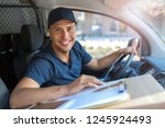 smiling delivery man sitting... | Shutterstock . vector #1245924493