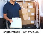 courier with clipboard and... | Shutterstock . vector #1245925603