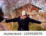 brunette young woman standing... | Shutterstock . vector #1245928570