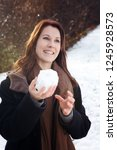 young brunette woman outdoors... | Shutterstock . vector #1245928573