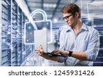 young it engeneer business man... | Shutterstock . vector #1245931426
