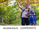 young couple walking in the... | Shutterstock . vector #1245935473