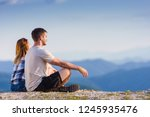 sitting on the top of the world ... | Shutterstock . vector #1245935476