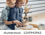 adorable young girls creating a ... | Shutterstock . vector #1245943963