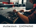 audio enginee fixing the set... | Shutterstock . vector #1245946960