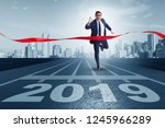 businessman on finishing line... | Shutterstock . vector #1245966289