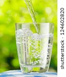 glass of water on nature... | Shutterstock . vector #124602820