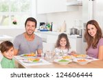 smiling family having dinner in ... | Shutterstock . vector #124606444