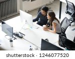 female colleague discuss... | Shutterstock . vector #1246077520