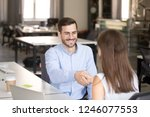friendly smiling employee... | Shutterstock . vector #1246077553