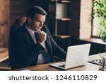 Profile side view portrait of elegant classy handsome focused man company founder owner manager wearing black jacket tie watching tutorial at workplace station