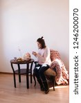 young brunette girl sitting in... | Shutterstock . vector #1246200070