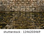 Closeup Of Stone Wall And Its...