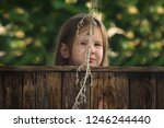 girl funny playing hide and... | Shutterstock . vector #1246244440