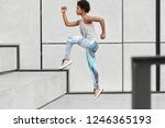 healthy fit woman runs up on... | Shutterstock . vector #1246365193