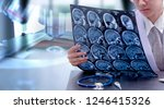 young female doctor holding mri ... | Shutterstock . vector #1246415326