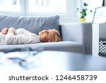 young woman taking a nap on... | Shutterstock . vector #1246458739