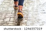 walk on wet melted ice pavement.... | Shutterstock . vector #1246557319