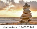 A Stone Tower At The Sea With...