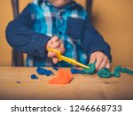 a little toddler is sitting at... | Shutterstock . vector #1246668733