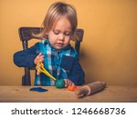 a little toddler is sitting at... | Shutterstock . vector #1246668736