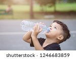 asian thai kids drink water in... | Shutterstock . vector #1246683859