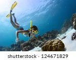 young lady snorkeling in a... | Shutterstock . vector #124671829