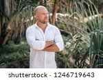 bald and bearded man in a white ... | Shutterstock . vector #1246719643
