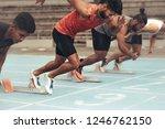 runners using starting blocks... | Shutterstock . vector #1246762150