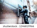 curly man entrepreneur in a... | Shutterstock . vector #1246819966