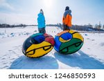 two persons pull sleighs to the ... | Shutterstock . vector #1246850593