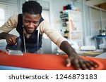 young man with iron preparing... | Shutterstock . vector #1246873183