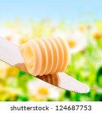 curl of fresh summer butter in... | Shutterstock . vector #124687753