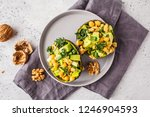 avocado halves stuffed with... | Shutterstock . vector #1246904593