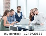 smiling business team looking... | Shutterstock . vector #1246920886