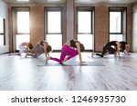 group of people doing yoga... | Shutterstock . vector #1246935730