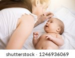 Young Mother Holding A Newborn...