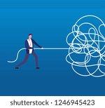 businessman unraveling tangled... | Shutterstock .eps vector #1246945423