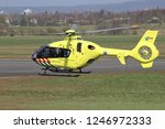 Small photo of SANKT AUGUSTIN, GERMANY - APRIL 9, 2015: ANWB Medical Air Assistance Eurocopter EC-135T2+ with registration PH-MAA departing after maintenance at Bonn Hangelar Airport.