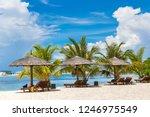 wooden sunbed and umbrella on...   Shutterstock . vector #1246975549